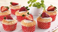Vanilla custard filled cupcakes made using Betty Crocker® cake mix and topped with strawberries make a wonderful dessert.