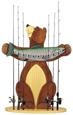 This bear is proud to display his catch of the day - a fishing rod holder like no other! Everyone who sees it will love it. Holds up to 10 rods. Make it from inch and inch stock. Fishing Pole Storage, Fishing Pole Holder, Pole Holders, Fly Fishing Rods, Fishing Tips, Woodworking Plans, Woodworking Projects, Woodworking Skills, Bear Fishing