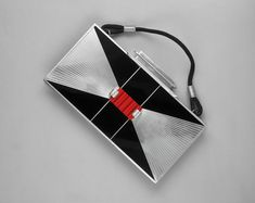 Art Deco in fashion.  This handbag shows the simple geometric shapes and contrasting colors characteristic of Art Deco.