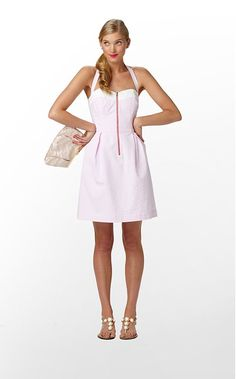 """Prominent zippers seem to be """"in"""". I sit on the fence most the time about zippers, but I love me a halter dress for warm weather. #lillypulitzer"""