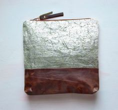 metallic leather clutch/makeup bag. CUTE