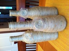 Pretty twine covered wine bottles! So easy to make! :)