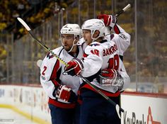 Nicklas Backstrom #19 of the Washington Capitals celebrates scoring a goal against the Pittsburgh Penguins with Dmitry Orlov #9 and Matt Niskanen #2 in Game Six of the Eastern Conference Second Round during the 2017 NHL Stanley Cup Playoffs at PPG PAINTS Arena on May 8, 2017 in Pittsburgh, Pennsylvania.