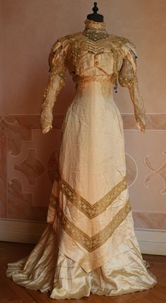 Whole dress in yellow silk with gold lace inserts in the same color.1909 Source