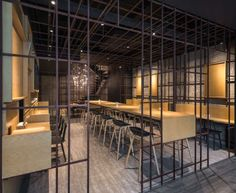 Noodle Rack - interior: This East meets West funky restaurant meets the sweet spot between fast food and upscale dining. The result is a hip restaurant where the architect cleverly uses design elements to mimic noodles inside with reflective metal wires to create...