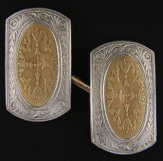 An elegant pair of Edwardian cufflinks with beautifully engraved and chased tops.  The cufflinks are crafted in 14kt gold with platinum overlays.  They date from the decades around 1910.