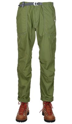 The Climbing Pants by and WANDER are a classic climb style trouser. Made up in a lightweight, garment dyed Nylon the pants feature an elasticated waist with snap fasten, a nylon web QR belt with reflective stitching detail two frontal fatigue style pockets, two rear zipped pockets and a zip fly.- 100% Nylon- Elasticated Waistband With Nylon QR Buckle Belt- Large Frontal Fatigue Style Pockets- Two Rear Zipped Pockets- Reflec Climbing Pants, Belt Buckles, Parachute Pants, Trousers, Clothes, Style, Fashion, Trouser Pants, Outfits