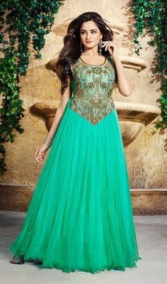 Be prepared to be showered with praises as you walk in this greenish blue net and tissue embroidered gown. This beautiful attire is showing some superb embroidery done with gold zardosi, resham and stones work. #LovelyDesignerWear