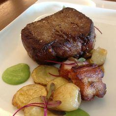 A special prepared Filet Mignon at Hilton Orlando's award winning restaurant, Spencer's for Steaks and Chops.