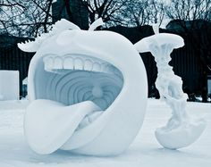 This cannib-apple.   29 Seriously Cool Snow Sculptures That Will Make You Want Another Storm
