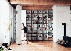 A bedroom hides behind this bookcase and is accessed through a secret door. Hide the bedroom door behind more unique bookcase. Apartment Interior Design, Bedroom Apartment, Floor To Ceiling Bookshelves, Architecture Renovation, Library Architecture, Contemporary Architecture, Architecture Design, Bookcase Door, Appartement Design