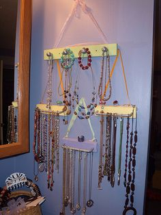 DIY Jewelry Holder. Oh I like this idea.