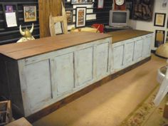 Distressed Retail Check-out Counter - Kitchen Island / Bar / Desk. $1,295.00, via Etsy.