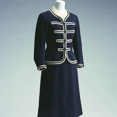 Day ensemble designed by Chanel for her own brand in 1956. Made from navy jersey with a white wool braid. Retrieved from KCI.