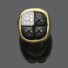 An onyx and diamond ring, by Pomellato. The square plaque divided into four sections, three of cabochon onyx and one pavé-set with brilliant-cut diamonds, signed Pomellato