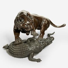 A fine Meiji bronze of a tiger and alligator, signed by Seiya.