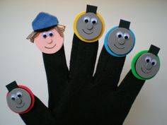 Finger puppet glove, what you cannot see is the magnet stuck to the figure and the magnet stuck to the glove... Great way to add finger puppets to a story!