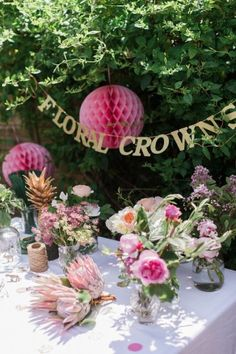Make centerpieces double as a bridal shower activity when you set out floral wire and tape for crafting flower crowns. When the girls are done arranging their wreaths, they'll serve a third purpose:bridal shower favors!