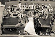 Wedding party in church pews