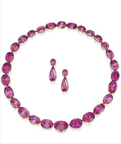 Antique gold and pink topaz necklace and earrings, 18th century. The graduated single-strand set with foiled-back oval pink topazes, length 18¾ inches, the earrings set with foiled-back oval and pear-shaped pink topazes, pendant detachable, total weight of the pink topazes approximately 200.00 carats. With fitted box.
