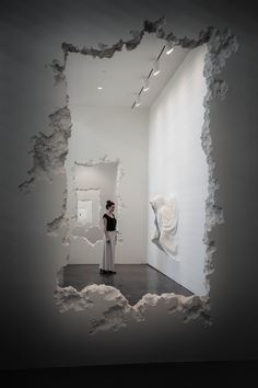 """In his latest exhibition, """"The Future Was Then,"""" Daniel Arsham(previously here and here) carved a path through the SCAD Museum of Art's Pamela Elaine Poetter Gallery utilizing a series of faux concrete walls. The 300-foot-long series of walls starts with the cutout of an abstrac"""