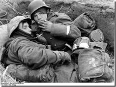 Two germans soldiers sharing a smoke during the battle of Seelow in april 1945.