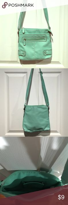 Seafoam Purse Seafoam colored purse. Two front pockets one with a zipper, one without. Two pockets on the inside on with a zipper, one without. Adjustable shoulder strap. Still has a lot of use left in it. Van Heusen Bags Shoulder Bags