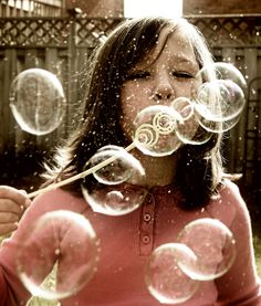 blow bubbles of wet shiny rainbow and chase them around as if they were impossible to pop.