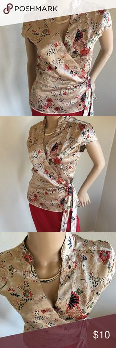 """🌸WRAP KIMONO STYLE SZL INSIDE TIDE CLOSURE 🌸WRAP KIMONO STYLE SZL . BUST 34-38"""" ADJUSTABLE WITH WRAP. FITS 8-12. INSIDE TIDE CLOSURE. HAS BEEN WORN BUT SUPER AWESOME! NO STAINS SNAGS RIPS HOLES ETC. STURDY SILK FEEL. Vintage Tops Blouses"""
