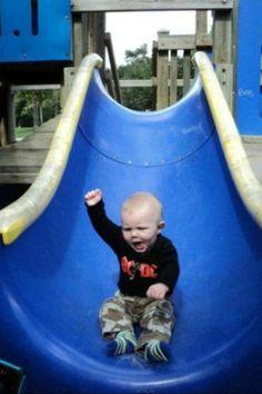 Cute Kid Conquers Slide!