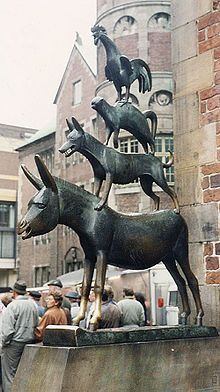 """The Bremen Town Musicians"" - Bremen, Germany, 1953 - The front legs of the donkey have been worn to a polish because it is deemed lucky to touch them. - Wikipedia, the free encyclopedia"