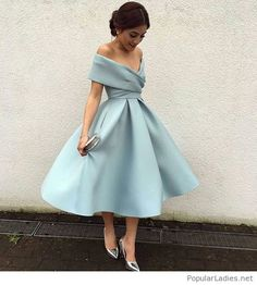 Light blue vintage dress style with silver accessories