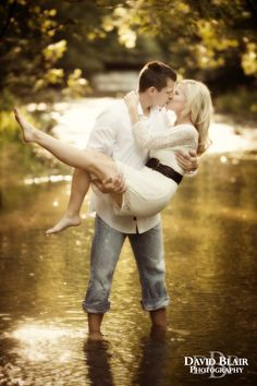 If you are willing to be a little playful you can get excellent Engagement Photos in a creek like Ashley and Nathan did. Photo by David Blair Photography.