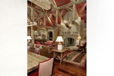 Gorgeous reclaimed barn conversion into a western home.  I love the red painted ceiling in this space, as it brings the volume of the room into scale.  So gorgeous!