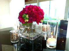 Example of minimal table centerpiece. Possibly using the bouquets as the flowers.