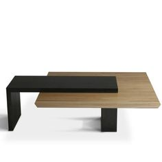 Hanging Slab Coffee Table from City Joinery.  Balancing Act   The contrast of light-colored elm and dark exotic woods creates a dynamic tension further expressed by the imposing cantilever. Mortise and tenon joinery keeps everything structurally secure.