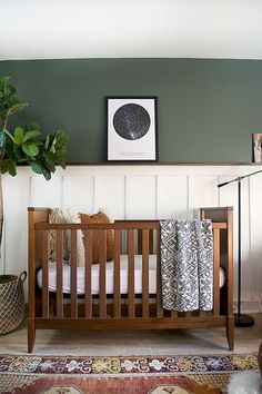 Modern and Vintage Boy's Nursery Reveal. A gorgeous nursery makeover with wood accents and a dark green wall. A Modern and Vintage Boy's Nursery Reveal featuring earthy, neutral tones and a boho vibe with a dark green accent wall and wood tones! Green Accent Walls, Dark Green Walls, Green Wall Color, Green Accents, Wall Colors, Paint Colors, Baby Bedroom, Nursery Room, Themed Nursery