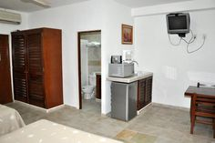 he upstairs rooms each have a small balcony with a table and chairs that over looks the pool and garden or Av. Hidalgo.