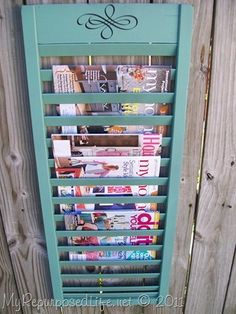 Fun for game room or office with magazines according to life style or room purpose..  Old shutter turned into magazine rack