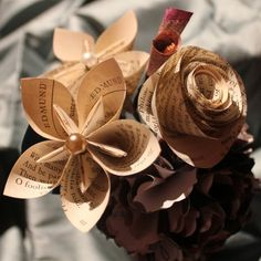 origami flowers made of recycled book pages