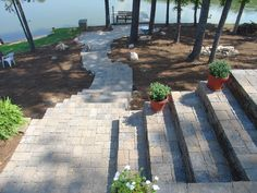 Ashlar Pattern Retaining Wall (Ashlar - Multiple sized blocks to make a random pattern) Top view showing pavers going all the way down to the lake. Ashlar Pattern, All The Way Down, Top View, Walkway, Random Pattern, Sidewalk, Stairs, Backyard, Retaining Walls