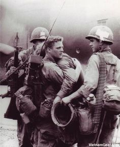 A Radioman comforts his friend who had just survived a battle during Operation Byrd in which nearly his entire platoon was wiped out.  Photo taken: August 1966