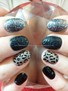 Black, silver and leopard print freehand gel nail art