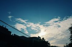 I was take a walk with my sister and we bringing our camera. We decided to took a shot since it's a good scenery. The run,  blue sky, cloud and the silhouette. Hihii