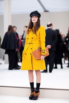 Electric yellow long coat with light brown clutch and heels