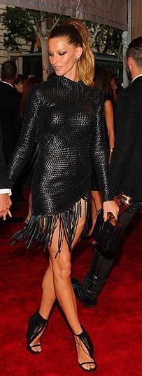 Who made Gisele Bundchen's black fringe dress that she wore to the 2010 Met Costume Institute Gala on May 3, 2010?   OutfitID