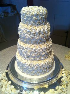 4 tier round wedding cake piped with buttercream roses