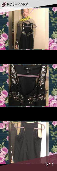 Black sleeveless blouse with sequins Black sleeveless blouse with sequin embellishments around the neckline.  2 buttons in front.  Back of shirt is plain. Iz Byer Tops Blouses