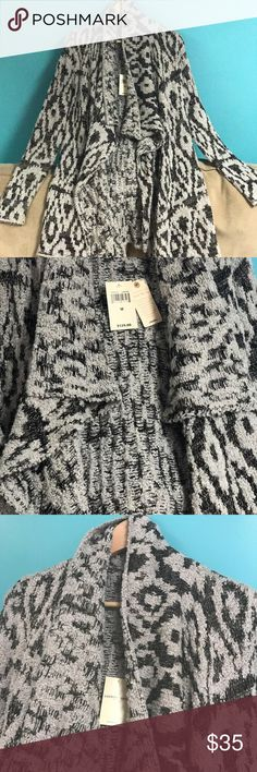 Lucky Brand Women's Metallic Boucle Cardigan Soft knit sweater boasts a relaxed fit. ; Stylized Lucky Brand missy long sleeve fashion cardigan sweater with contrast print metallic detail.   Stripe throughout with a geometric inspiration. ; Open-front design. ; Long-sleeve coverage. ; Cascading fold-over collar. ; Straight hemline at a tunic length. ; 66% cotton, 19% acrylic, 12% polyester, 3% other fiber. Measurements: ; Length: 33 in ; Product measurements were taken using size XS (US 0-2)…