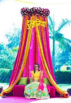 Looking for Mehendi decor idea with bright pink and yellow theme and bridal seat? Browse of latest bridal photos, lehenga & jewelry designs, decor ideas, etc. Desi Wedding Decor, Marriage Decoration, Wedding Stage Decorations, Wedding Mandap, Backdrop Decorations, Wedding Ideas, Indian Wedding Favors, Party Backdrops, Wedding Props